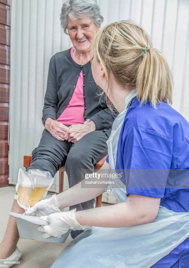 senior woman with catheter : Stock Photo