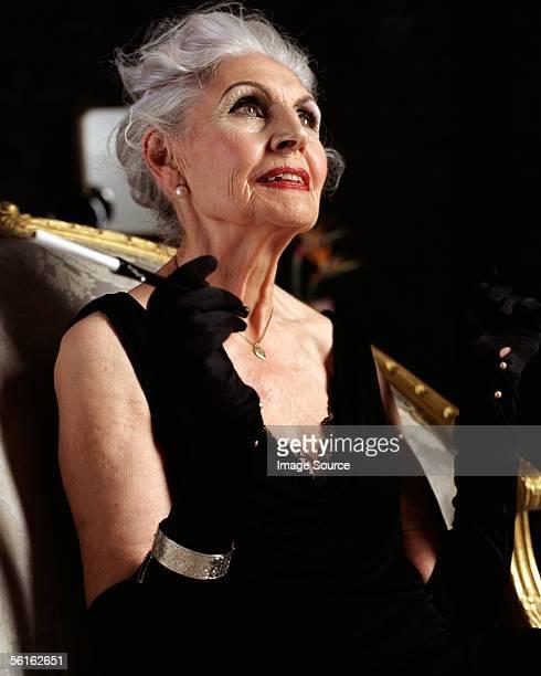 Senior woman with cigarette holder