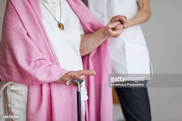 senior woman with cructh get support - fotostock stock-fotos und bilder