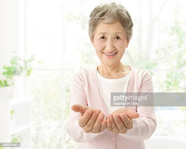 Senior Woman With Cupped Hands