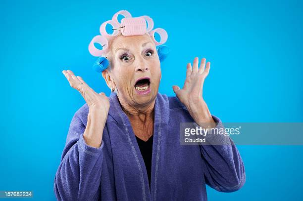 senior woman with curlers is shouting - old ugly woman stock photos and pictures
