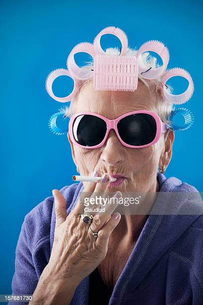 senior woman with curlers - very ugly women stock photos and pictures