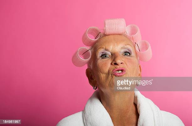 senior woman with curlers - old ugly woman stock photos and pictures