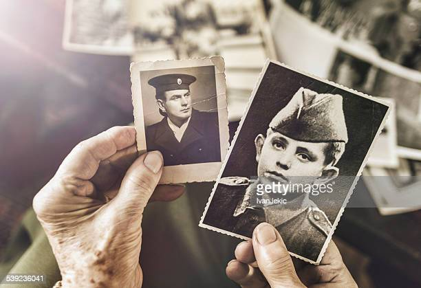 senior woman with dear photographs of her husband - death photos stock photos and pictures