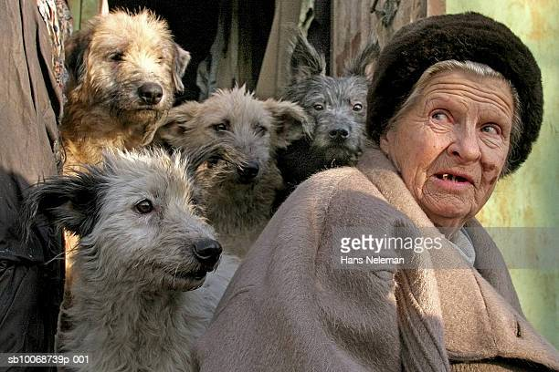 Senior woman with dogs, close-up
