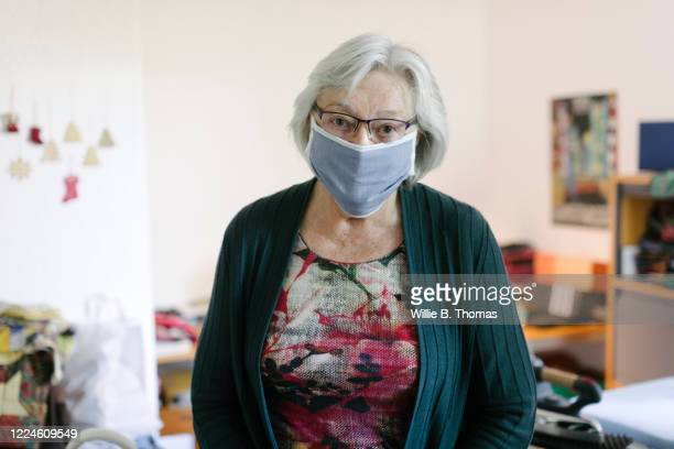 senior woman with face mask - over 80 stock pictures, royalty-free photos & images