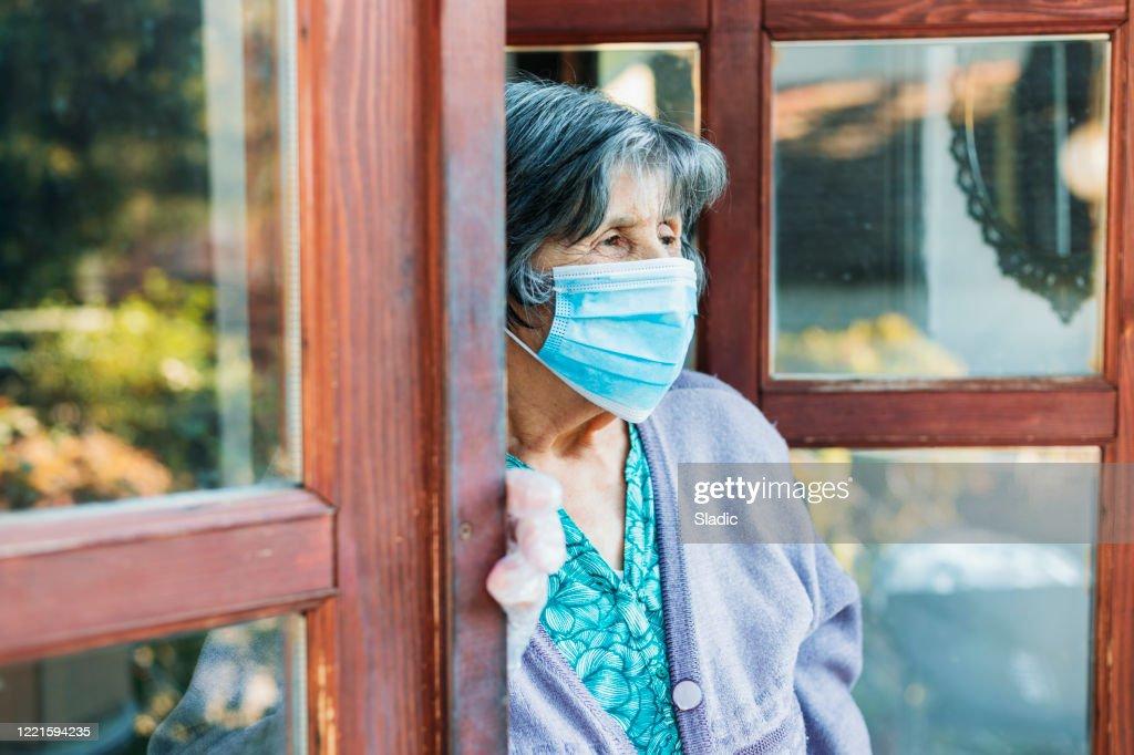 Senior woman with facial mask : Stock Photo
