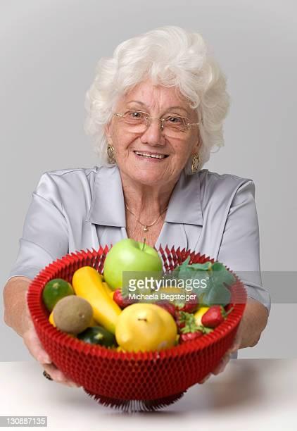 Senior woman with fruit basket