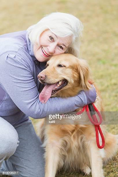 Senior woman with golden retriever