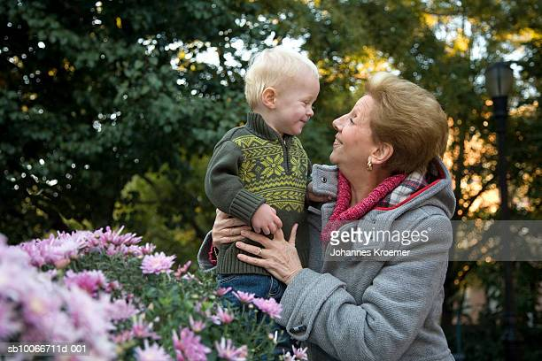 senior woman with grandson (18- 23 months) in garden - 18 23 months stock pictures, royalty-free photos & images