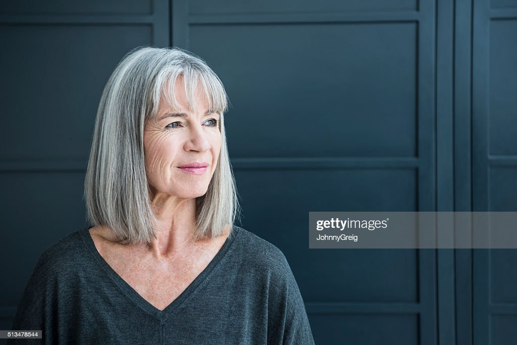 Senior woman with gray hair looking away : Stock Photo