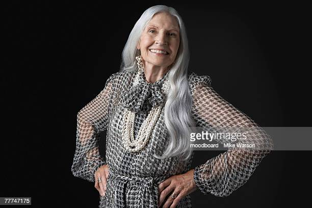 senior woman with hands on hips - arms akimbo stock photos and pictures