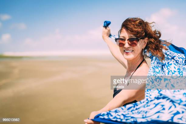 senior woman with hat enjoying the outdoors - maranhao state stock pictures, royalty-free photos & images
