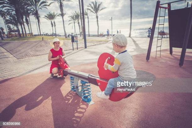 Senior woman with her grandsan at the playground