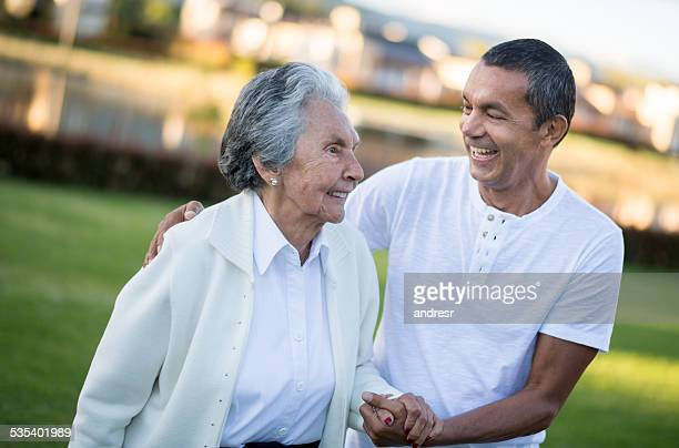 senior woman with her son - mother and son stock photos and pictures