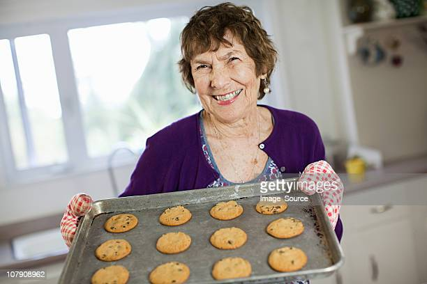 Senior woman with home baked cookies
