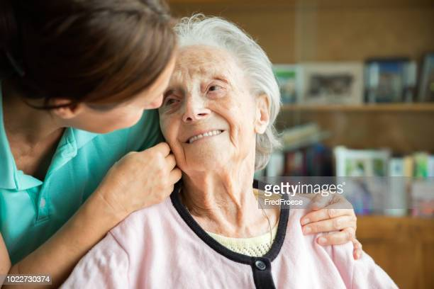 senior woman with home caregiver - home caregiver stock pictures, royalty-free photos & images