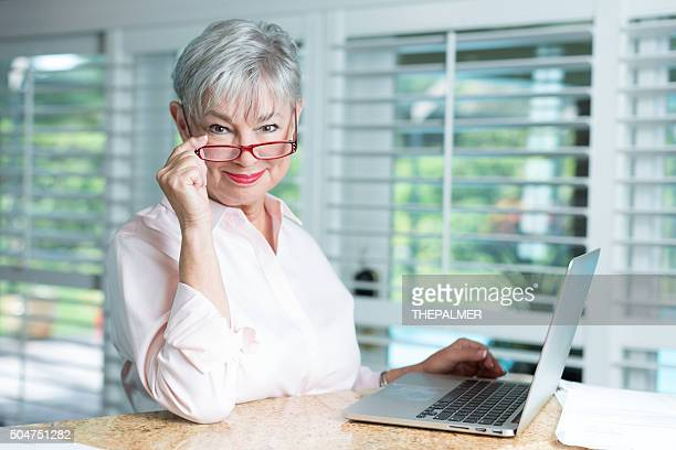 senior woman with laptop - grandma invoice stock pictures, royalty-free photos & images