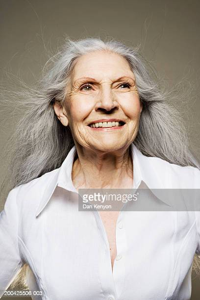 senior woman with long hair wearing white shirt, smiling - white shirt stock pictures, royalty-free photos & images