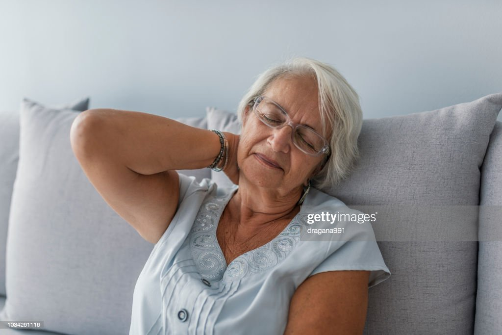 Senior woman with neck-ache : Stock Photo