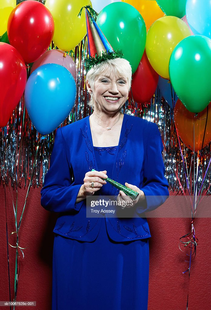 Senior Woman With Party Blower Celebrating New Years Eve ...