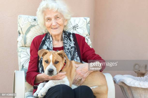 Senior Woman with Puppy