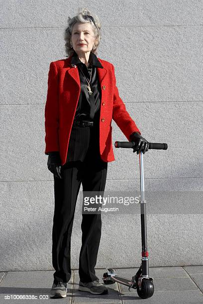 Senior woman with push scooter
