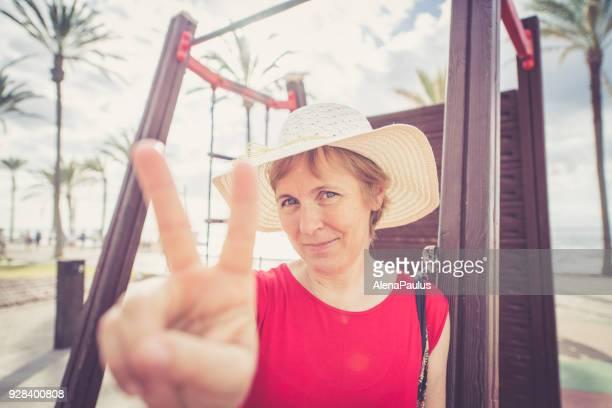 Senior woman with sun hat