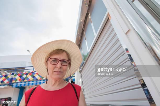 Senior woman with sun hat portrait