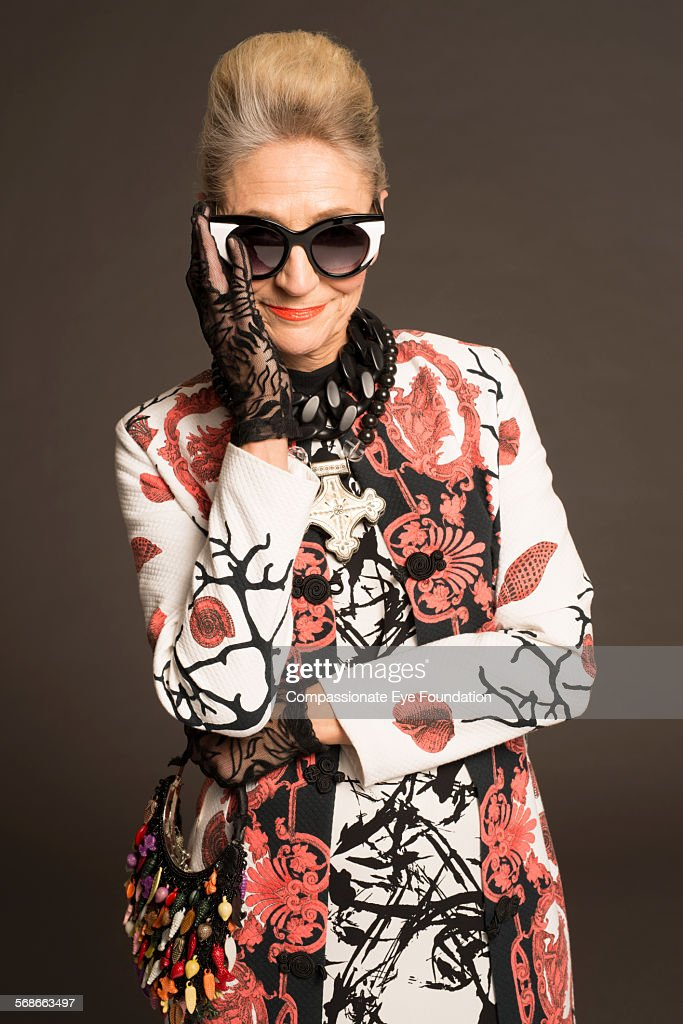 Senior woman with sunglasses and stylish clothes : Stock Photo