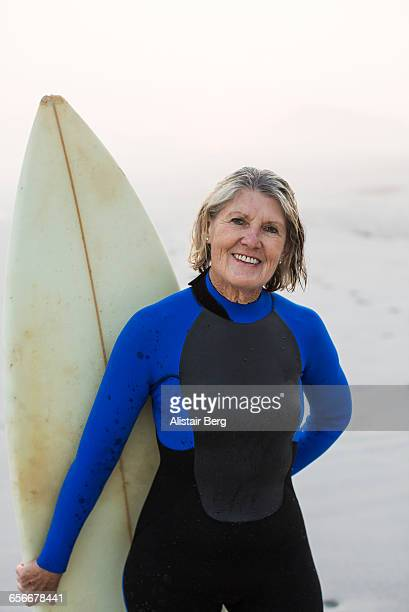 Senior woman with surf board