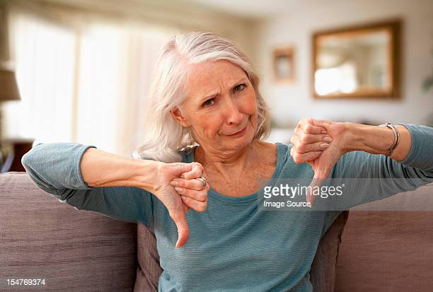 Senior woman with thumbs down