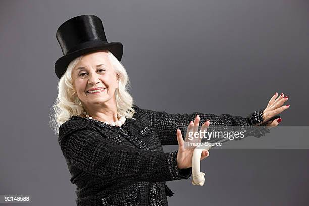 Senior woman with top hat and cane