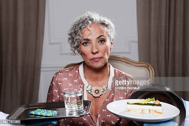 Senior woman with two lunch trays