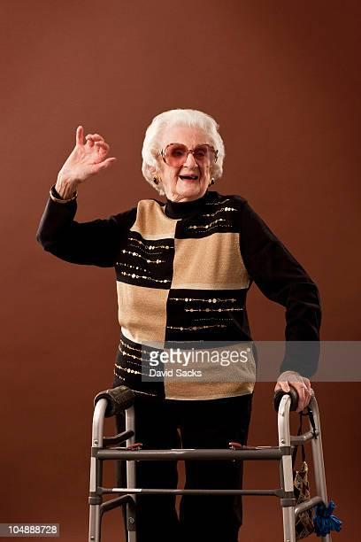 Senior woman with walker dancing