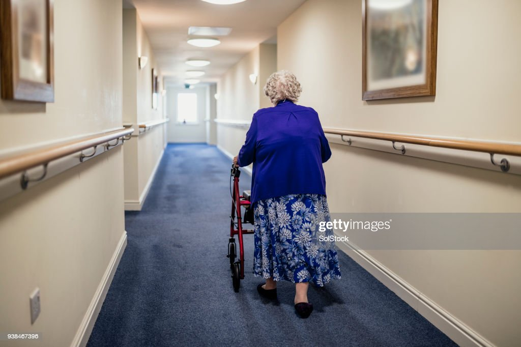 Senior Woman with Walker in a Care Home : Stock Photo