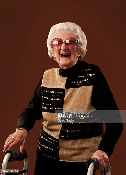 Senior woman with walker laughing