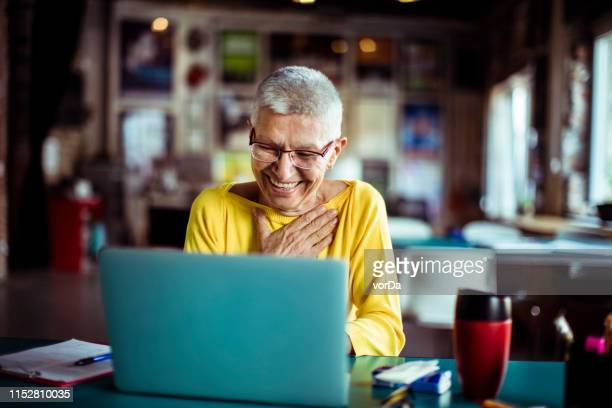 senior woman working in a office - disruptaging stock pictures, royalty-free photos & images