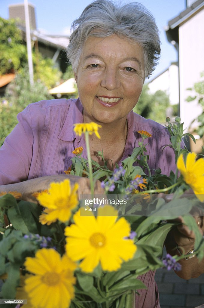Senior woman working in her garden : Stock Photo