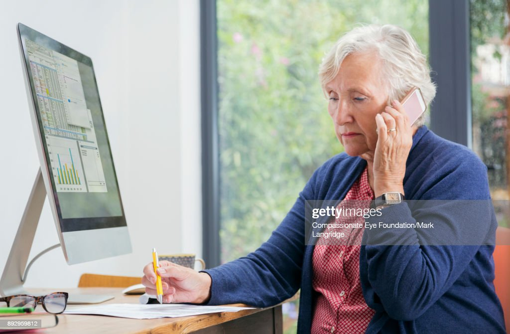 Senior woman working in home office : Stock Photo
