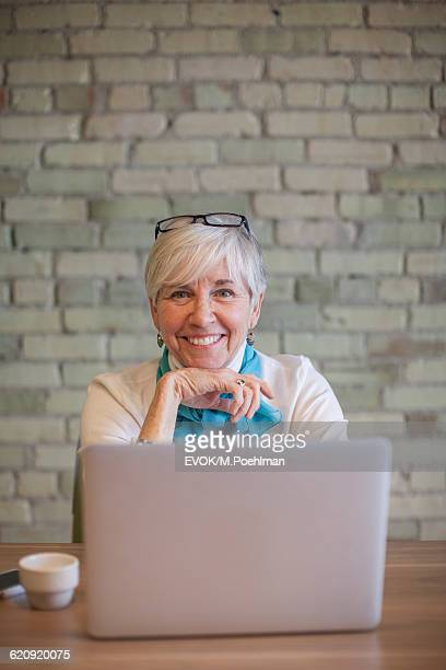 Senior woman working on computer in office