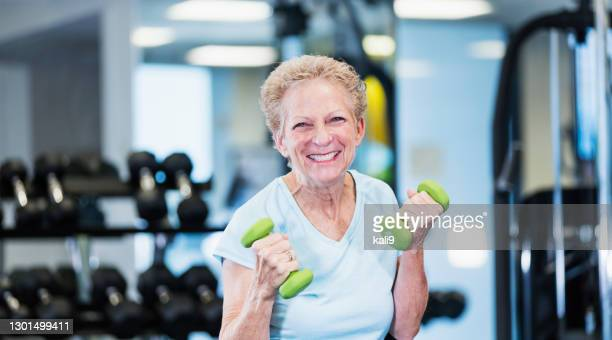 senior woman working out at the gym - hand weight stock pictures, royalty-free photos & images
