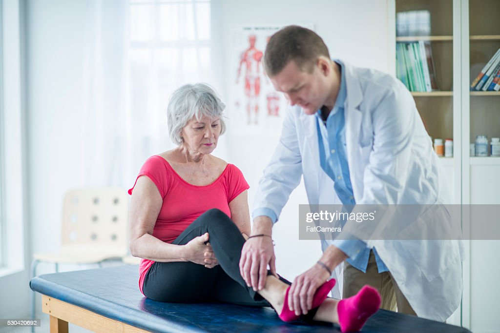 Senior Woman Working with a Physical Therapist : Stock Photo