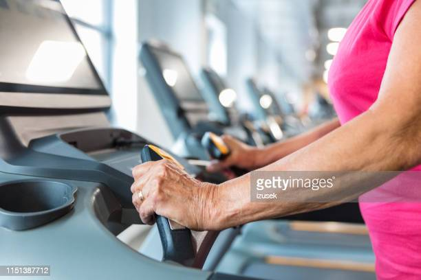 senior woman workout on treadmill at gym - drug rehab stock pictures, royalty-free photos & images