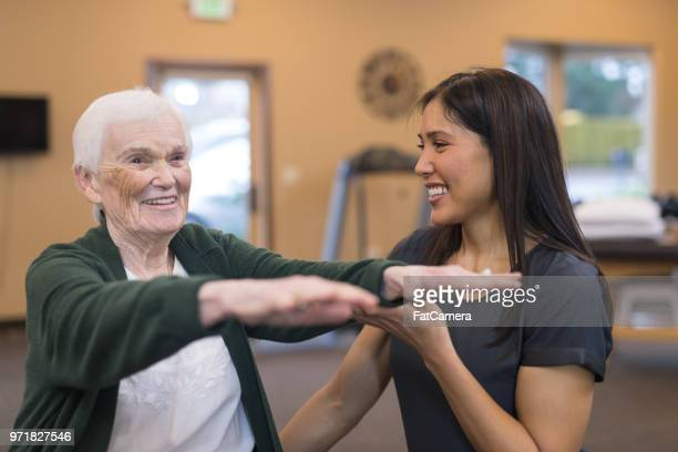 a senior woman works with her occupational therapist - balance stock pictures, royalty-free photos & images