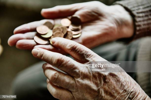 senior woman's hands with coins - poverty stock pictures, royalty-free photos & images