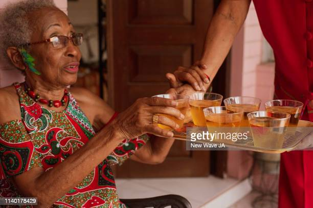 Senior Women Being served Juice