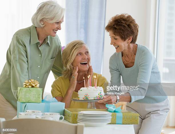 Senior women celebrating friend's birthday