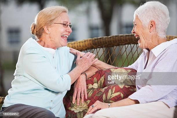 Senior women chatting on patio