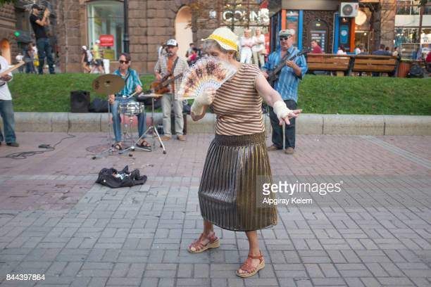 senior women dancing on the street - old women in pantyhose stock photos and pictures